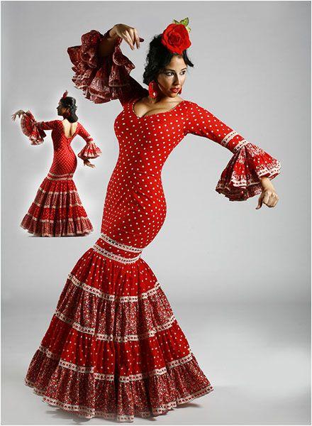Vestido canastero confeccionado en batista con lunares y estampado, traje flamenco entallado hasta las caderas con mangas de tres cuartos con volantes y escote en pico. http://www.elrocio.es/moda-flamenca-2014-trajes-de-flamenca/1604-vestidos-flamenca-temporada-2014.html