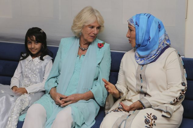 Camilla, the Duchess of Cornwall talks to an Omani woman at the Oman Cancer Association's ...