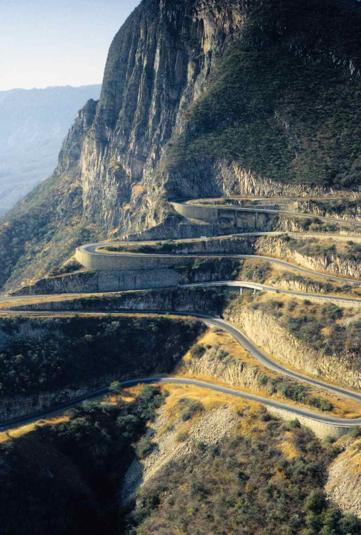 An impressive, man-made switchback road on the face of the Serra da Bandeira mountains near Leba, Angola. During colonial rule in the 1960s, Portuguese engineers chose the shortest route to climb the mountain to connect Lubango with the coastal city of Namibe. The road incorporates numerous hairpin bends in the road using methods employed in the Swiss Alps.