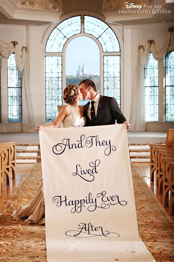 """And they lived happily ever after"" - This Disney couple used their aisle runner for a cute shot in Disney's Wedding Pavilion"