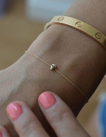 """tiny skull bracelet... what an awesome way to take my metal side with me everywhere in a """"girly"""" way."""