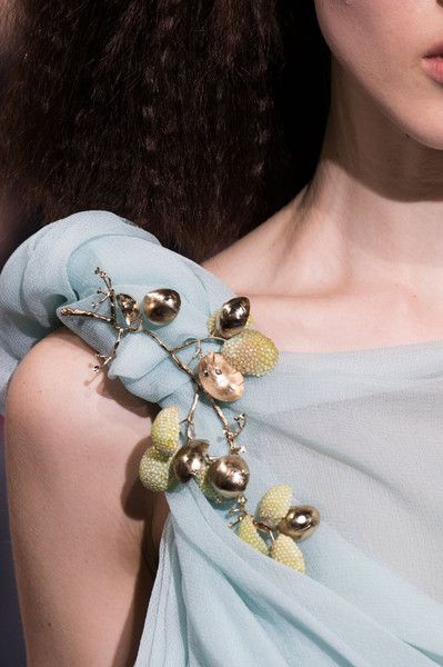 Schiaparelli at Couture Spring 2016. Love the unique use of this brooch.