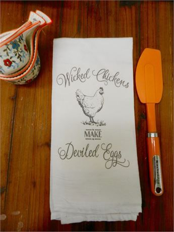 Handmade cute graphic kitchen tea towel with a graphic image of Wicked Chickens Make Deviled Eggs  The farmhouse decor image has a vintage look with some faded spots throughout. Please note the imperfections as I think these give the towel a vintage look. Any lines you see in the image are from the many natural creases in the cotton material . The black script on this towel is lighter than usual  This is not vinyl lettering  The graphic image has been transferred by a commercial heat press…