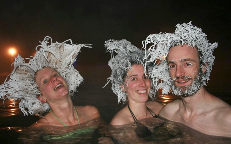 Bathers show off their frozen hair while bathing in a 40 degree Celsius (104   Fahrenheit) pool in air temperatures of -30 C (-22 F) at Takhini Hot Springs   in Whitehorse, Yukon. The resort hosts the International Hair Freezing   Contest and offer a first prize of $150.
