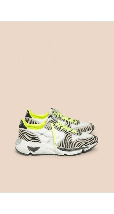 daadab1193c3 These zebra print sneakers feature lace-up at top, a rounded toe, and