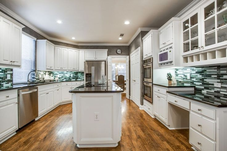 Traditional Kitchen with Raised panel, Slate counters, Kitchen island, High ceiling, Glass panel, Hardwood floors, U-shaped