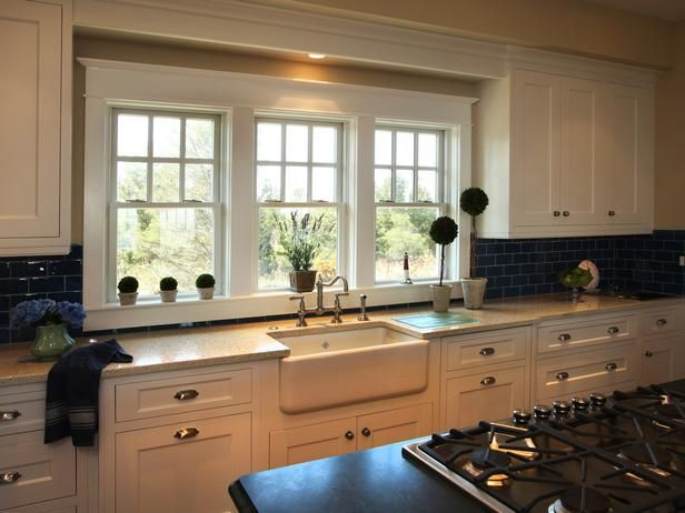 I LOVE the blue tile backsplash in this one! - 79 Beautiful Kitchen Window Options and Ideas on HGTV