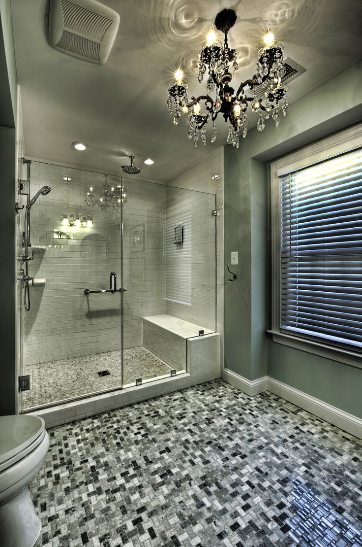 Black and white walk-in shower design by Moss Building & Design.