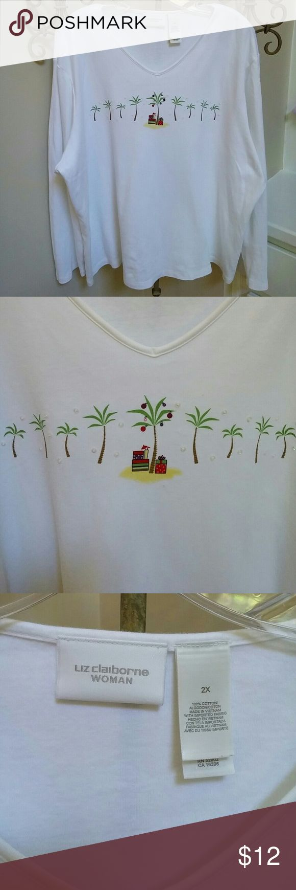 "Christmas island palm trees gifts shirt 100% cotton knit shirt has palm trees with sequins around them. The tree on the ""island"" is decorated and gas gifts under it, along with a tropical drink. Note the tiny pink fit under the island. 25in underarm to underarm and about 25in shoulder to hem. Liz Claiborne Tops Tees - Long Sleeve"