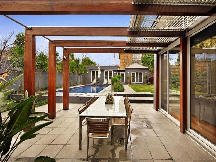 outdoor area ideas with tiles, timber and pergola