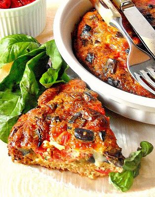 Eggplant omelette with tomatoes and caciocavallo cheese baked in the oven