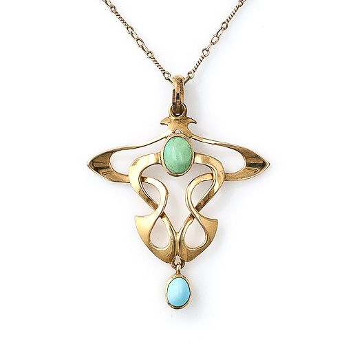 This sinuous and curvaceous Art Nouveau pendant features two turquoise cabochons - one green and one robin's egg blue. This vintage jewel displays the classic whiplash design characteristic of the turn-of-the-century Art Nouveau design. 10KT gold