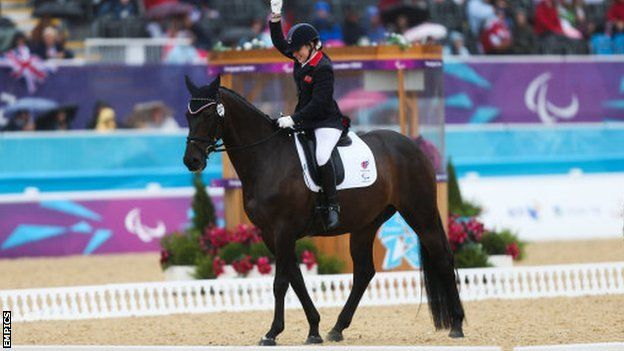 """Great Britain rider Natasha Baker won gold in the Paralympic Grade II individual equestrian event.  Riding Cabral on her Paralympic debut, Baker set a Grade II record of 76.857%.  Defending champion Britta Napel of Germany finished second with a score of 76.048%, with team-mate Angelika Trabert in third with 76.000%.   """"Considering I have got no use of my legs, he really does have to try hard. He is a super horse."""""""