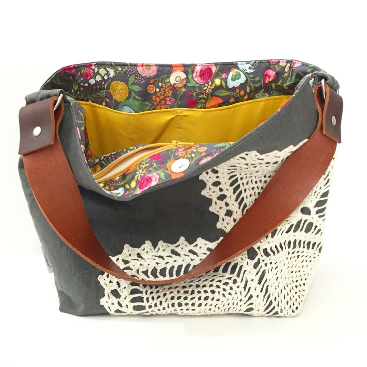 Fun floral lining in this grey vintage doily hobo.