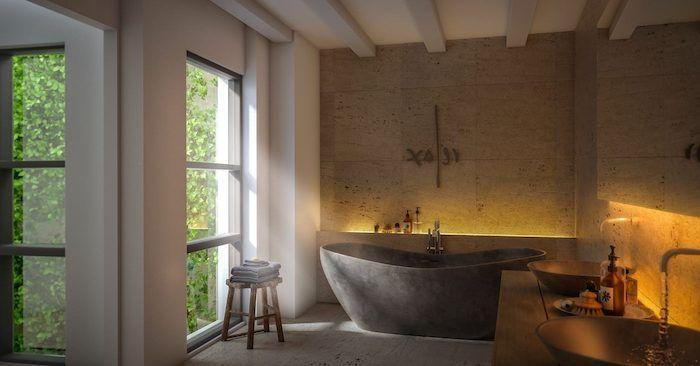 moderne badezimmer, graue freistehende badewanne aus naturstein, badezimmerbeleu…
