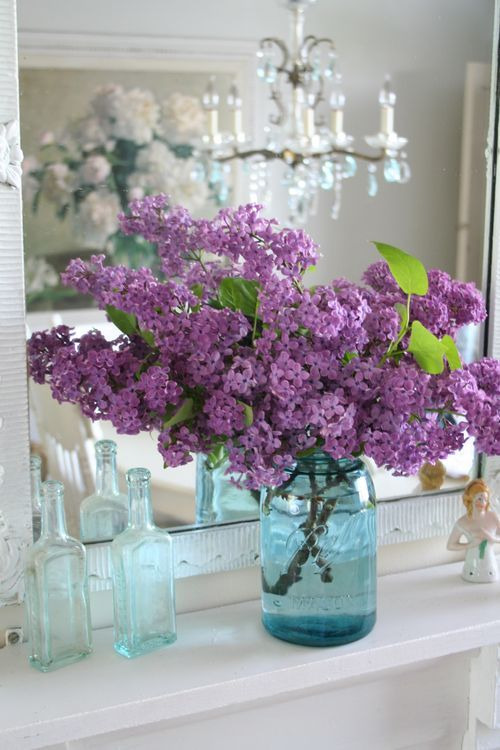 lilacs in a turquoise mason jar