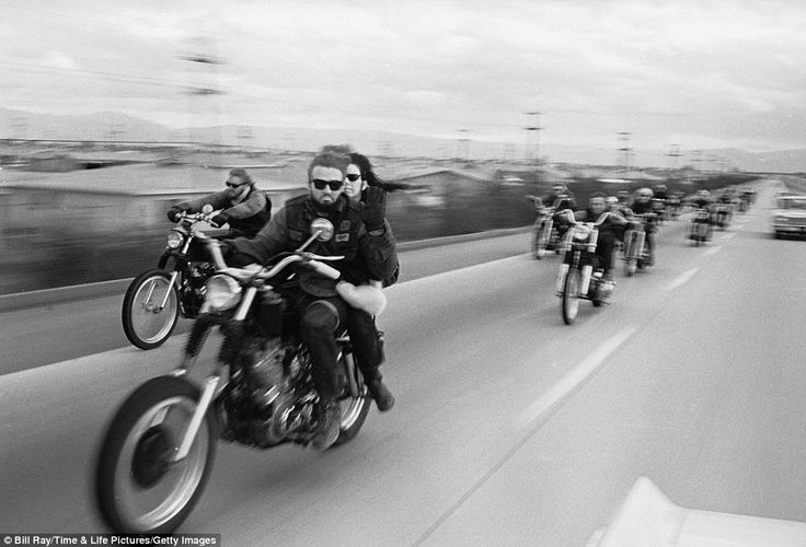 Capturing life in the fast lane: Fascinating 1965 shots of Hells Angels by photographer who infiltrated famously secretive club released for the first time