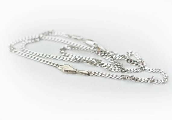This is a solid 14k white gold chain necklace made in my studio.  The ouroboros head and tail is hand carved and shined! Minimalist flat chain necklace. 2.2 mm wide chain. 5 x 15 mm snake head and tail. Would make a wonderful, one of a kind gift for someone who loves snakes/serpents/ouroboros! 39 cm long, that is 15.3 inches. An extender chain can be added to make it larger if you need larger. ONLY UNIQUE ONE AVAILABLE! Once it is sold, it is gone for good...  Please check out my ot...
