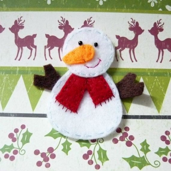 Felt snowman. You could put magnet strip on the back, and instead of sewing just use glue, and for the mouth and scarf fringe use a red marker...simple and fun!