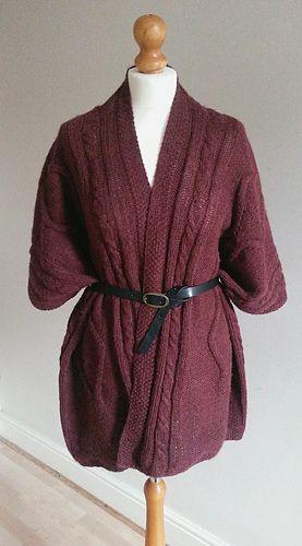 Knitted ruana wrap pattern with cable motifs.  @MrsUMakes #mymrsumakes