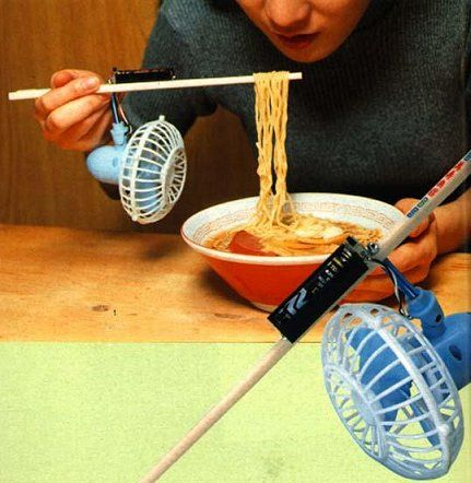Noodle Cooler Chindogu:  Tired of hot noodle soup burning your mouth?  This practical fan attaches conveniently to your chopsticks so you need never suffer from pesky noodle burn again!