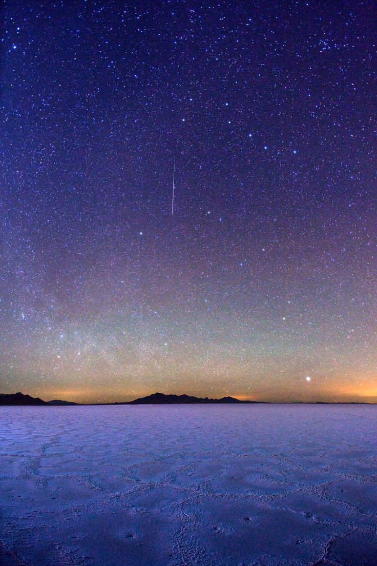 A photograph of a meteor streaking between the Big Dipper and Polaris on January 4, 2012 in Salt Lake City, Utah