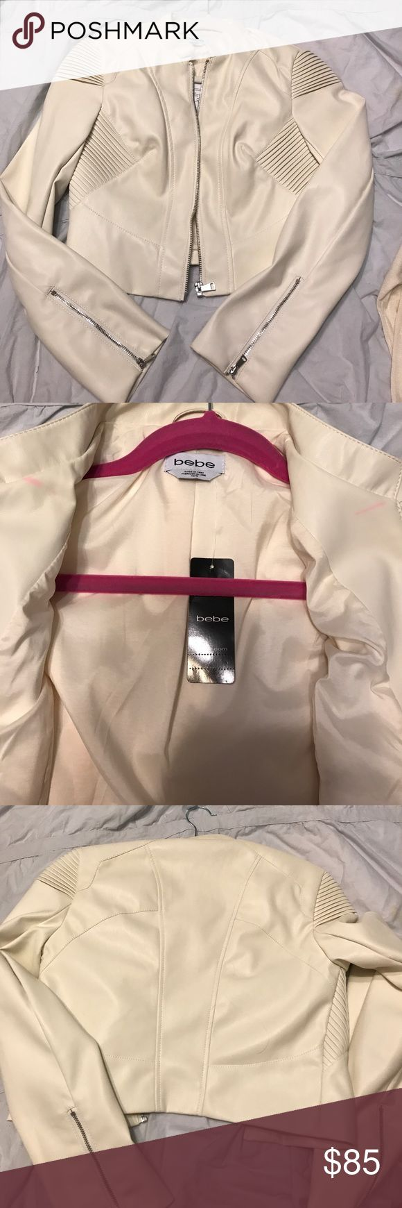 New BEBE leather jacket xs Brand new leather jacket from Bebe size xs. It's a cream off white color! Bought and never ended up wearing! It's been hanging in my closet there is two small pink spots in the inside from the hanger resting on it.  But they seem to come out by rubbing them! bebe Jackets & Coats