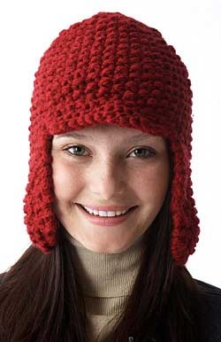 Keep extra-warm and protect your ears from the cold with this classic Earflap Hat. Sized to fit average lady's head, shown knit in Paton's Shetland Chunky #03532 (Deep Red) on size 6.5 mm (U.S. 10.5) knitting  needles.