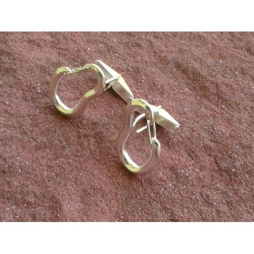 Climbing Carabiner Cufflinks. The carabiners are fully functional: The gate is spring loaded and arches back when you open it!