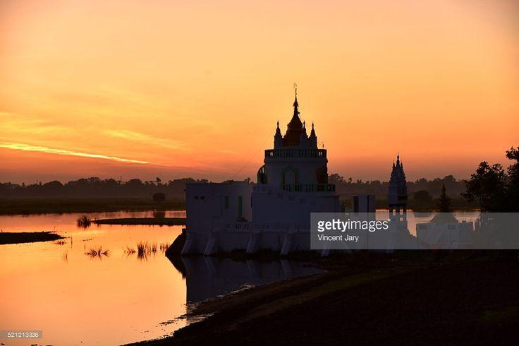 Near U Bein Bridge a sunset with temple on background. Amarapura, Mandalay region, Myanmar #getty #gettyimages #photo #photography