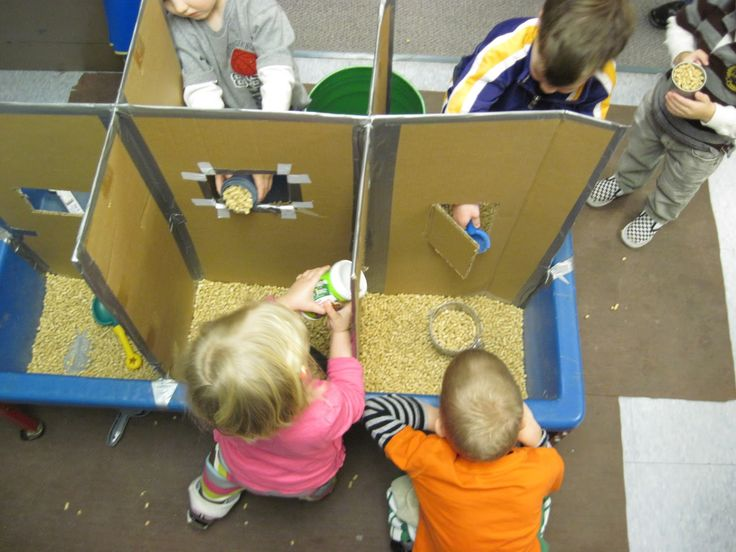 "SAND AND WATER TABLES: RUMINATIONS ON CARDBOARD DIVIDERS. ""I started out to make a simple apparatus to partition the sensory table to cut down on the squabbles. Once the children got a hold of it, though, it became dynamic. Part of that was because of the spaces it created, but the biggest part was what the children did in, around, and through those spaces."" Pinned by Alec of http://childsplaymusic.com.au/"
