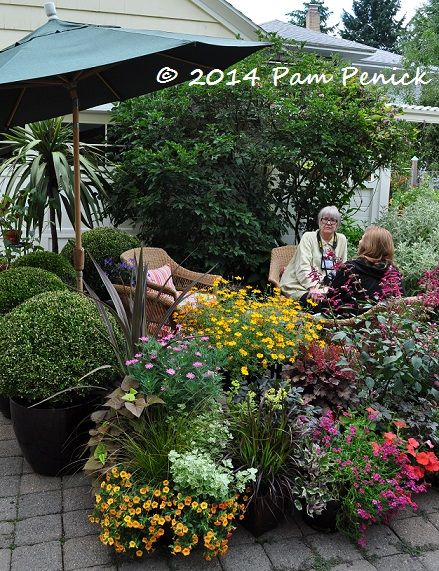 Lawn gone, and driveway gone too! Don't have room for a patio? Put it on the garden and surround it with container plants. The Dancing Ladies Garden of Linda Ernst: Portland Garden Bloggers Fling | Digging
