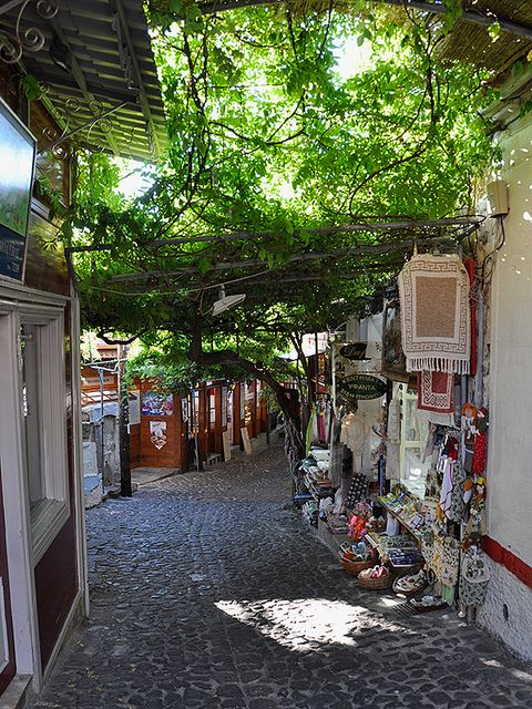 Small shops on the streets of Molyvos, Lesbos Island, Greece (by Drriss).