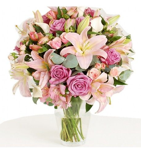This arrangement contains the following flowers: 8 x Blue Dutch Roses 5 x Lilies Oriental Pink 5 x Pink Spray Roses 5 x White Calla Lilies 6 x Pink Alstroemeria 1 x Bunch of Cinera.