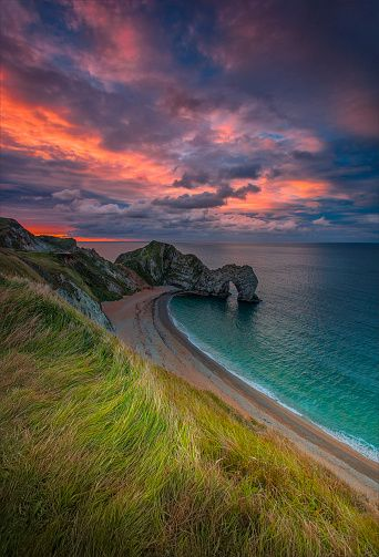 Durdle Door is a natural limestone arch on the Jurassic Coast near Lulworth in Dorset, England. It is privately owned by the Welds, a family who owns 12,000 acres in Dorset in the name of the Lulworth Estate. It is open to the public.