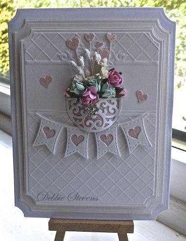 Morning everyone, Todays card is using as always Spellbinders grand labels as my base layers, The embossing folder is sizzix 'thank you' set no 5, Spellbinders layered scalloped posy, la la land he...