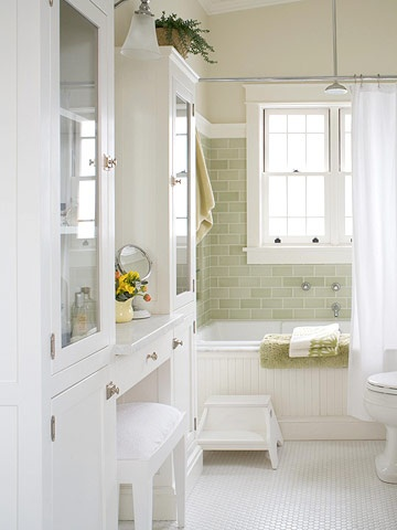 This craftsman-styled bath would be the perfect design for the master bath in my dream bungalow. Love the sea green subway tile, the vanity, and the glass front cabinetry.