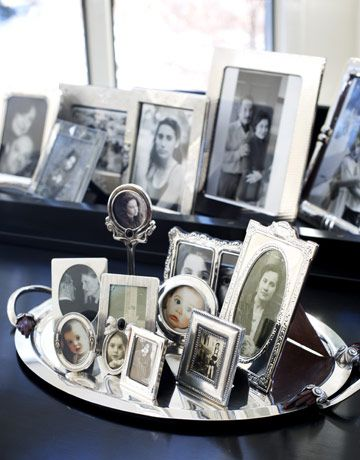 Tiny silver frames on a silver tray.
