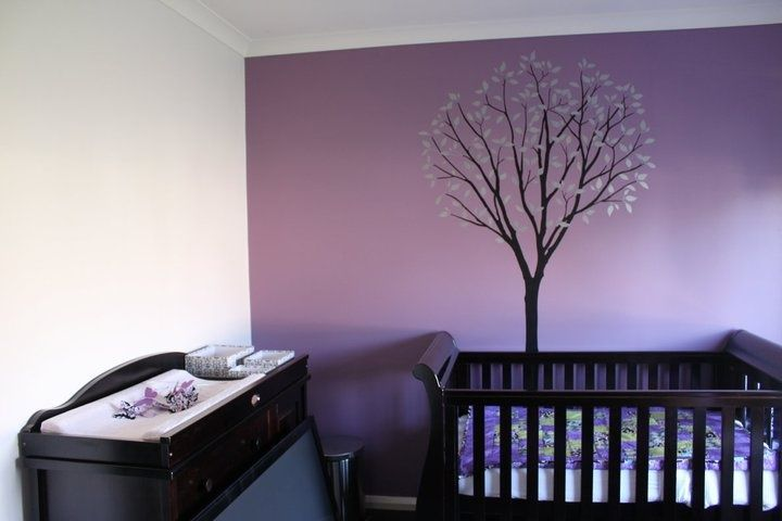 nursery with purple accent wall