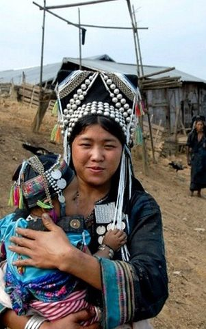 Laos   Akha Meuo mother holding her baby in her arms. Ban Chakhampa, Phongsali Province   © Imagebrokerrm