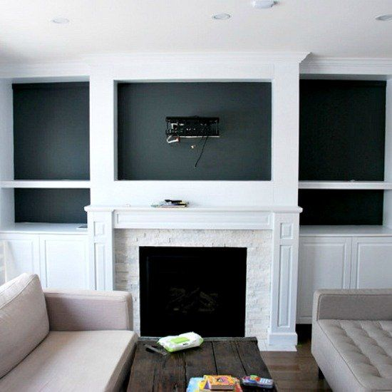 The building of a fireplace built-in. Complete with cabinet doors, open shelving, white and dark gray paint, and craftsman style.Full how to