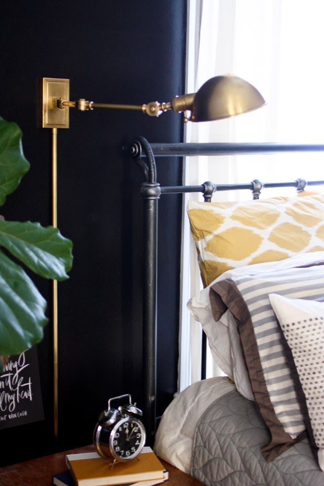 Lesley Graham: Room Tour: Our Bedroom. Plug-in light sconce with