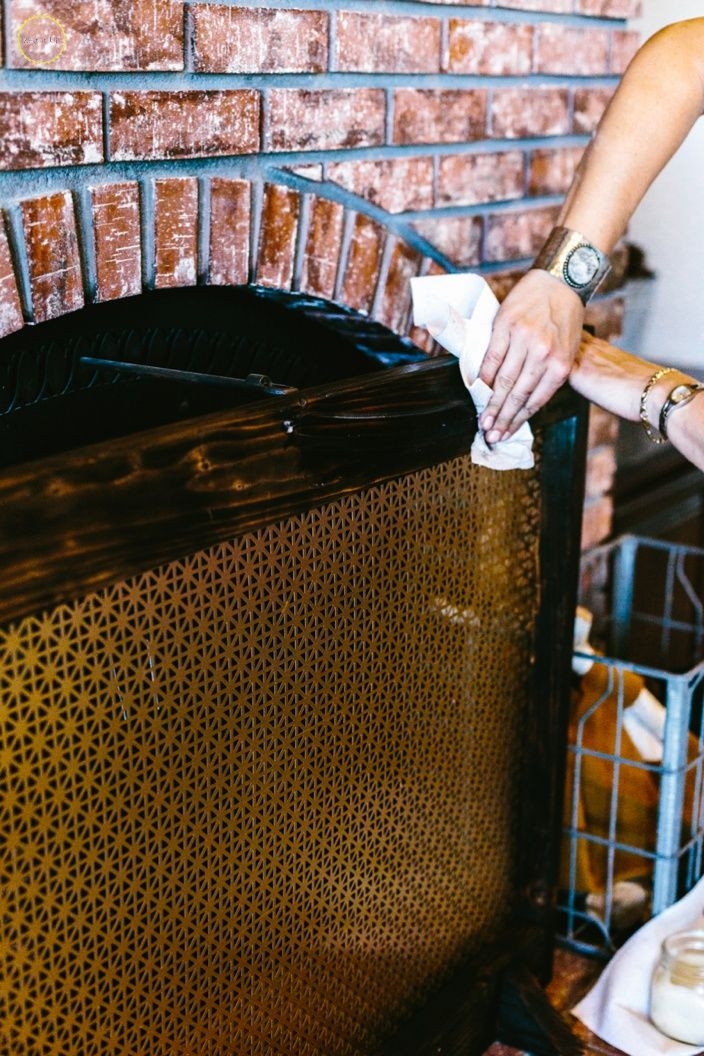 A DIY fireplace screen using a cool radiator screen.  Nice modern lines...and really easy to make!