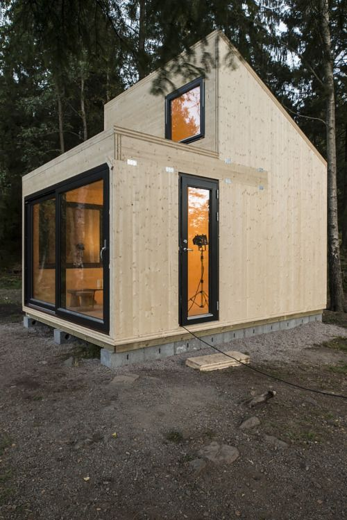 Woody15 – A Tiny Cross-Laminated Timber Cabin - Large sliding doors (possible on corner instead of front) with flat & arched roof