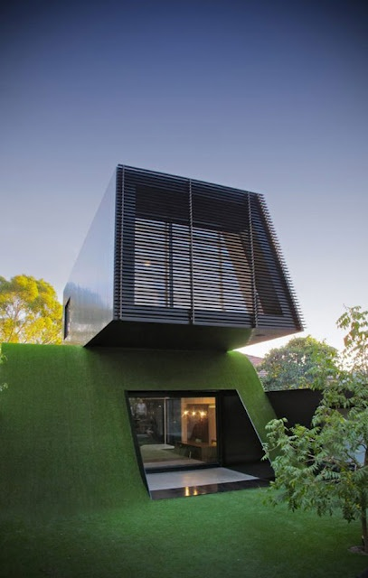 In the beautiful yet flat Melbourne, Australia architect Andrew Maynard Architects created a landscape by building an artificial hill, and built a new contemporary structure atop the green hill for a family of 5.  So cool.