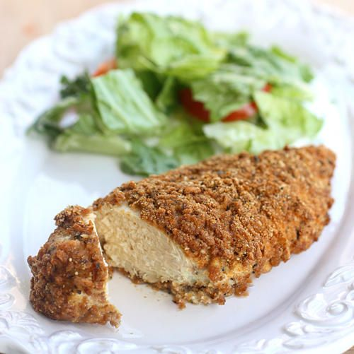 174 calorie Fiber One-Parmesan Crusted Chicken    4 boneless skinless chicken breasts      1/4 cup Parmesan cheese      1/2 cup Fiber One cereal      1/2 teaspoon onion powder      1/2 teaspoon garlic powder        1 teaspoon Italian seasonings      1 egg white      salt and pepper      cooking spray