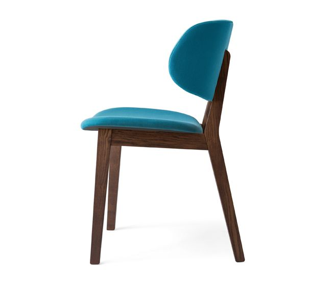 Featuring a wraparound backrest, Calligaris' ash Claire chair resembles the cupped curves of a blossoming flower. It's also available in vernal tulip tones like yellow and red.