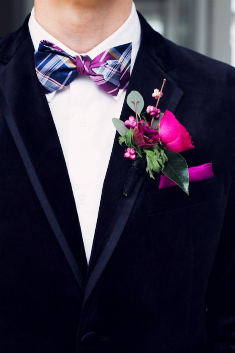 A navy blue velvet jacket pairs well with deep purple and pink jewel tones in bow tie and boutonniere. Photography by Jamie Lauren #groomstyle #groomattire #tuxedos