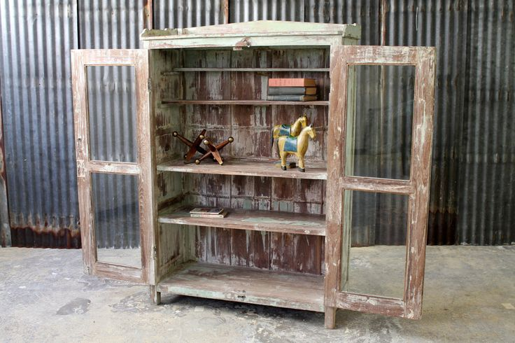 This is a true, reclaimed antique kitchen cabinet with naturally worn patina and lightly carved, deco-motif facade. After careful restoration by acid washing, r