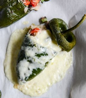 cheese smothered stuffed poblanos I howsweeteats.com....This recipe rocks...it presents beautifully...so great for company...and the taste is 5 star restaurant flavor...made my top 10 list